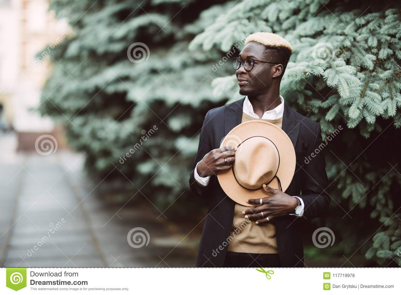 Handsome Afro American man in casual wear and sun glasses walking outdoors  in the street 745d2d3c96d3