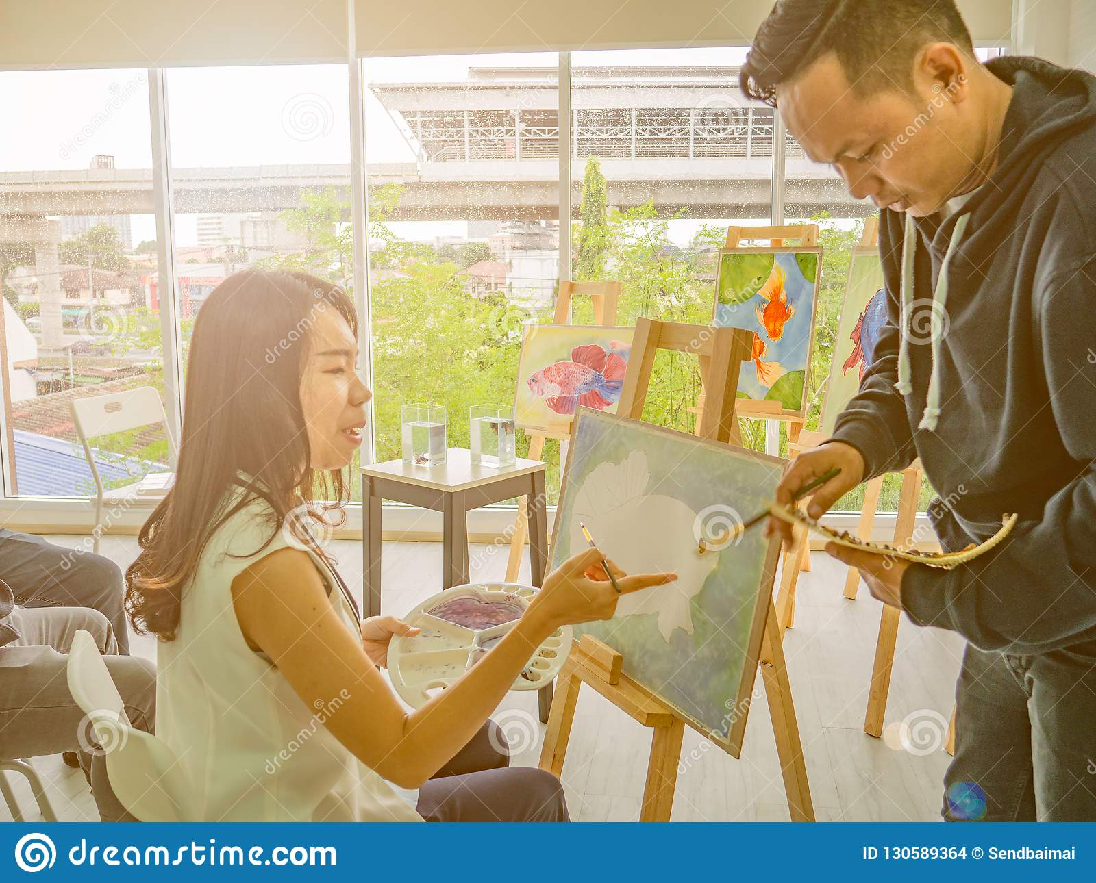 Handsome Young Asian man or water color artist Teaching how to paint and artist student Learning the class