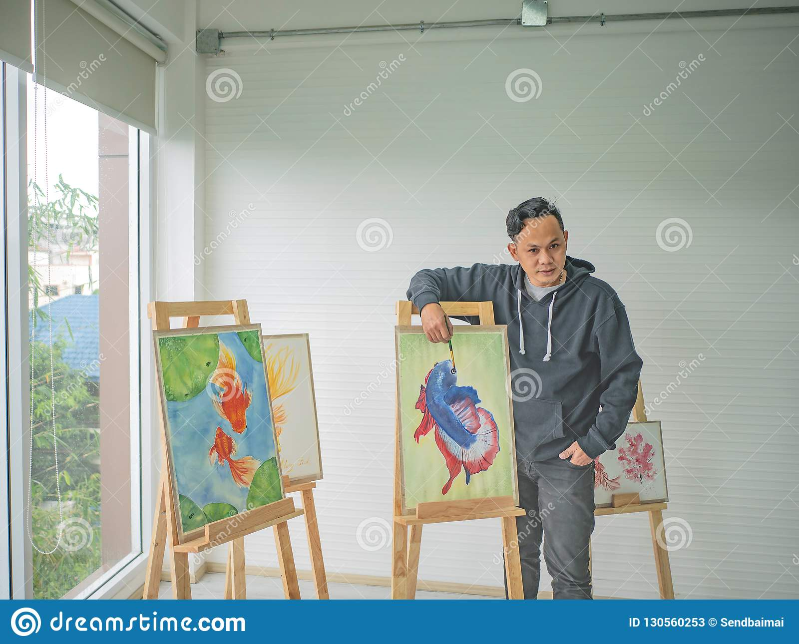 Handsome Young Asian man or water color artist Teaching how to paint