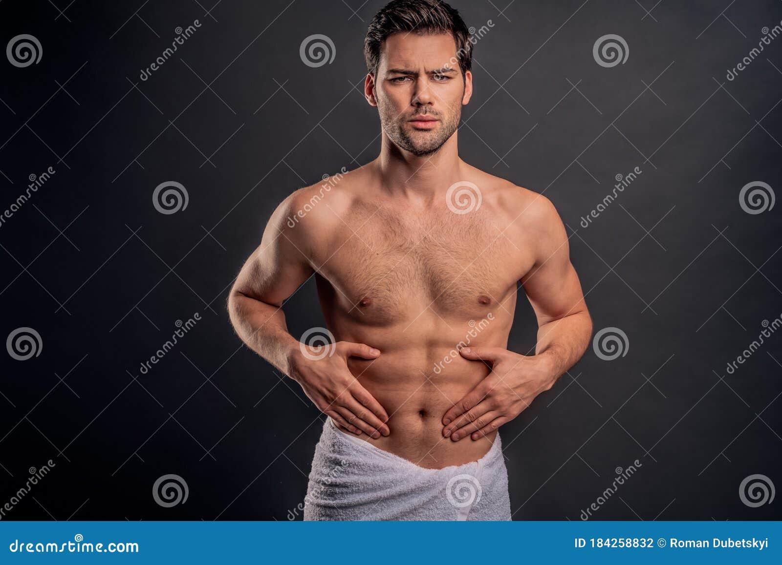 Studio Shot Of Young Muscular Persian Man Holding Gun And