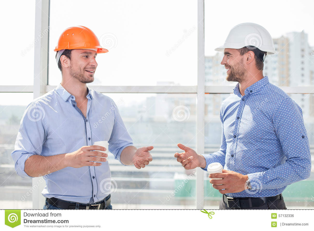 Handsome young builders are relaxing after work