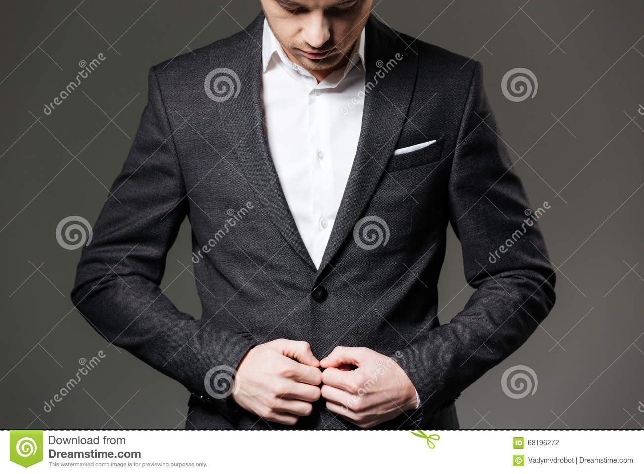 handsome young businessman in black suit and grey necktie