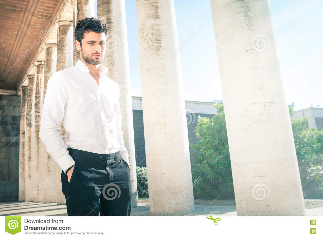 Handsome young elegant man outdoors. Nervous and pensive.