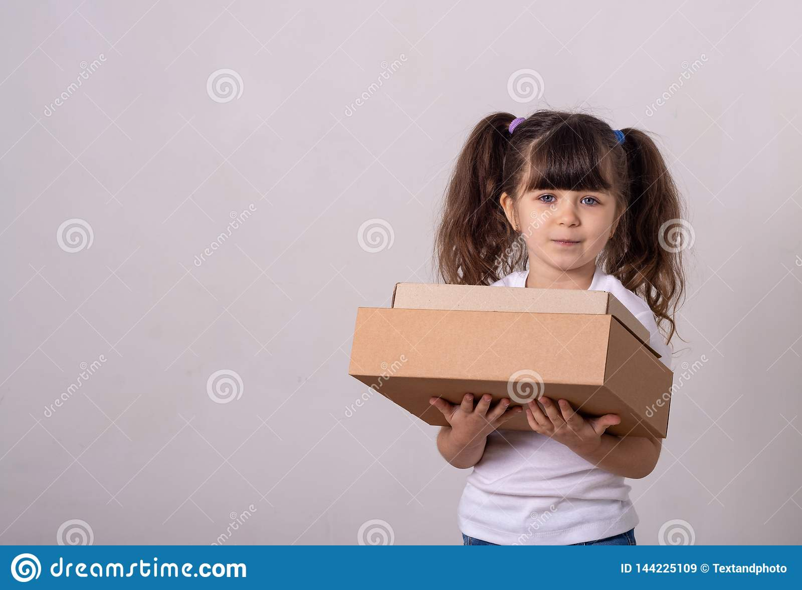 Kid delivering package over white background.