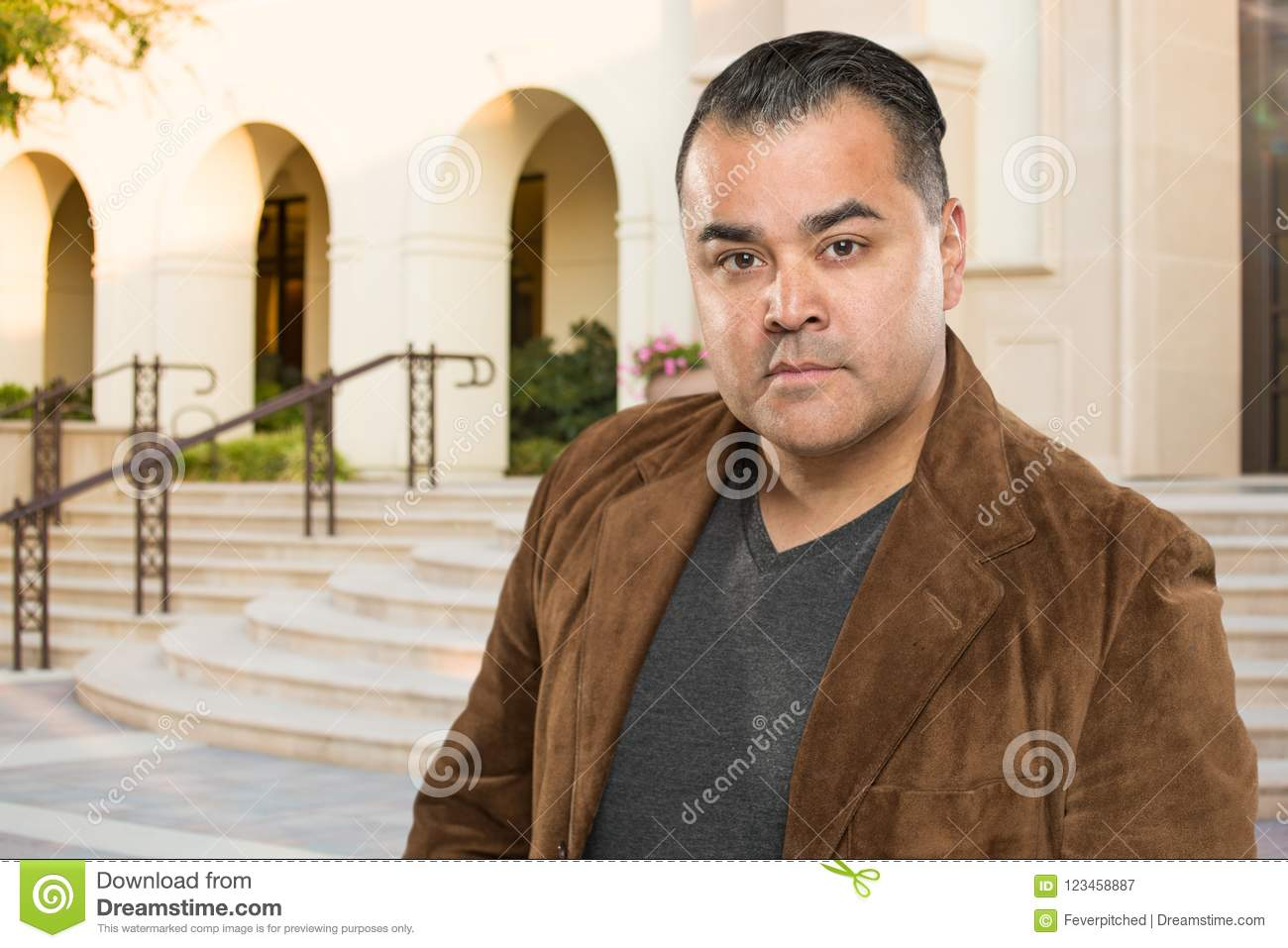 Handsome Young Hispanic Adult Outside of Building