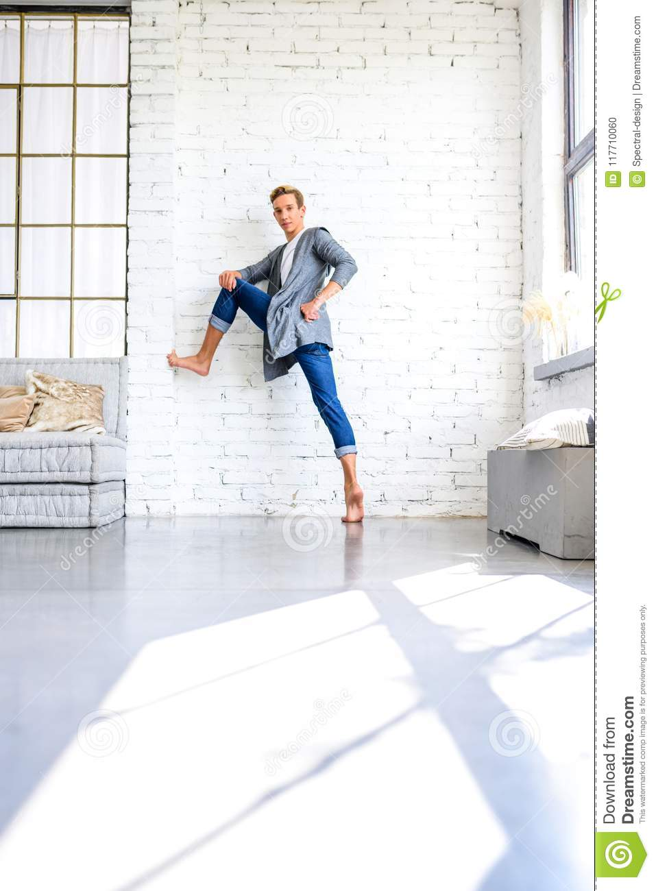 A handsome young male Ballet dancer practicing in a Loft style A