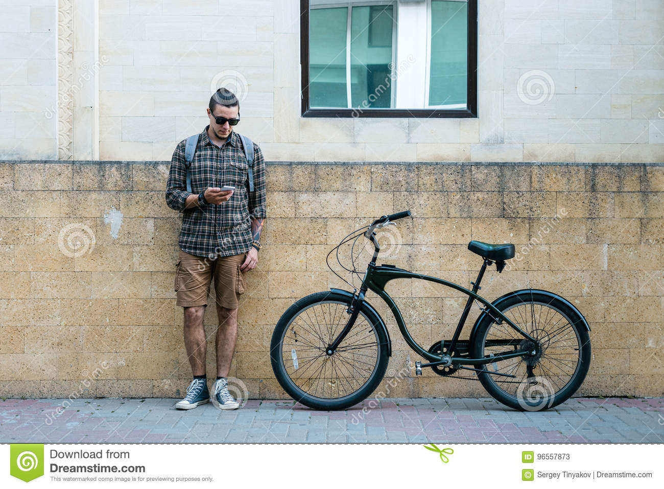 Download Handsome Young Man Cyclist Standing Next To Bike And His Looking At Smartphone. Street Lifestyle Urban Everyday Concept Stock Image - Image of everyday, cyclist: 96557873