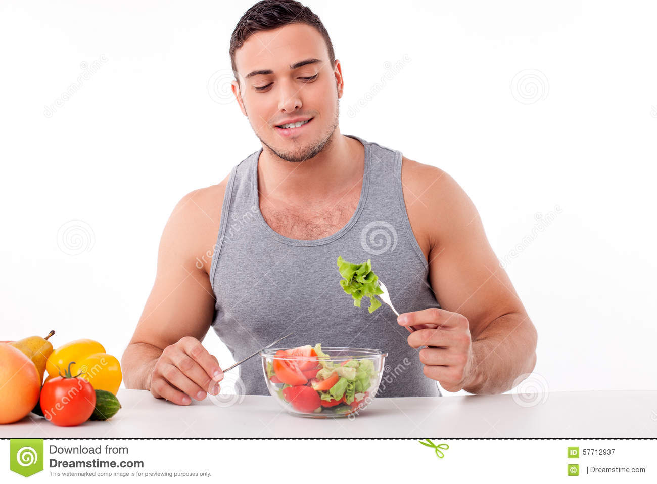 handsome young man is eating healthy food stock image