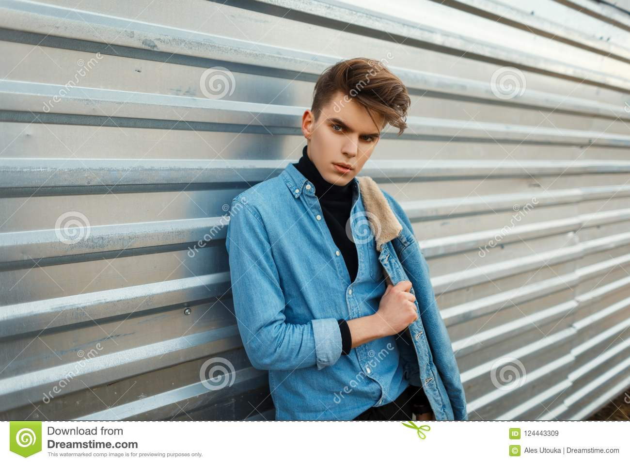 Handsome Young Man With A Hairstyle In Fashionable Jeans Clothes