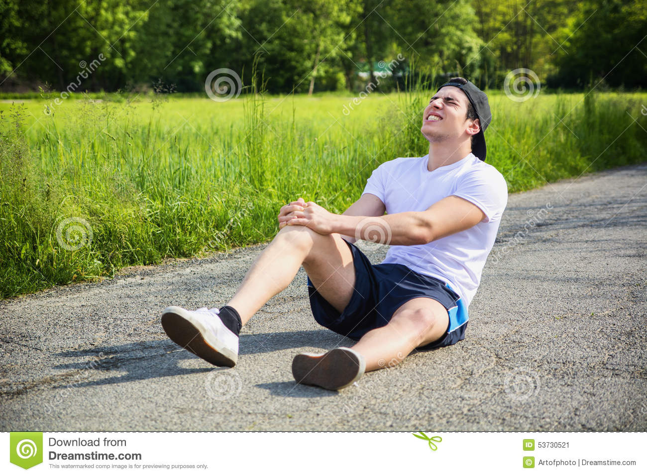 Handsome young man injured while running and