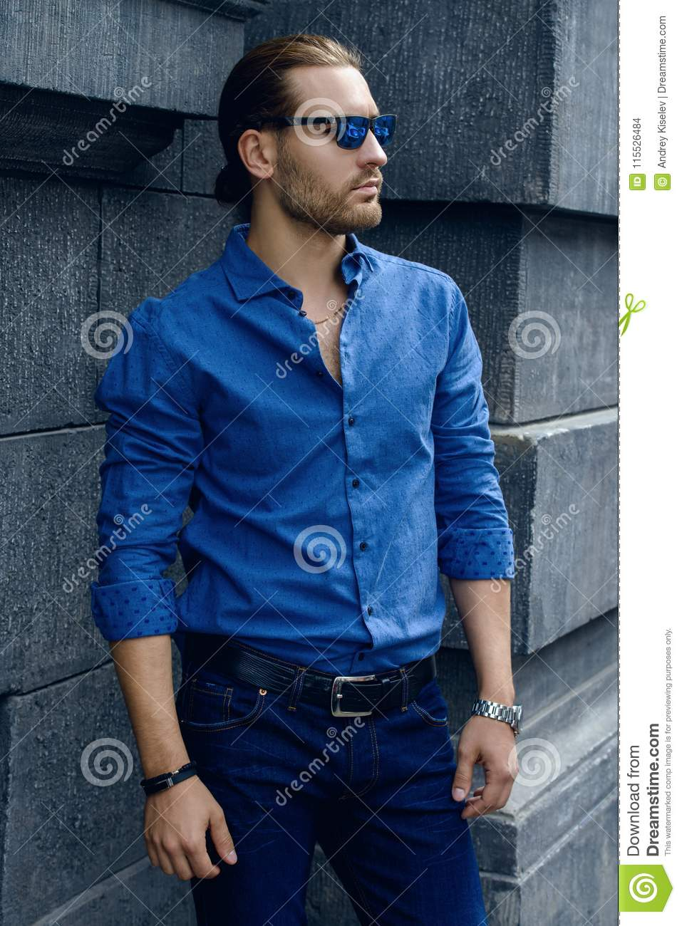 20f2bd5d Handsome young man in jeans clothes stands on a city street. Men`s fashion.  More similar stock images