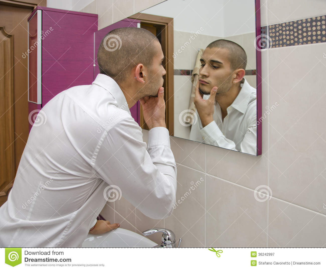 Handsome Young Man Looking At Himself In Bathroom Mirror Royalty Free Stock Photography Image