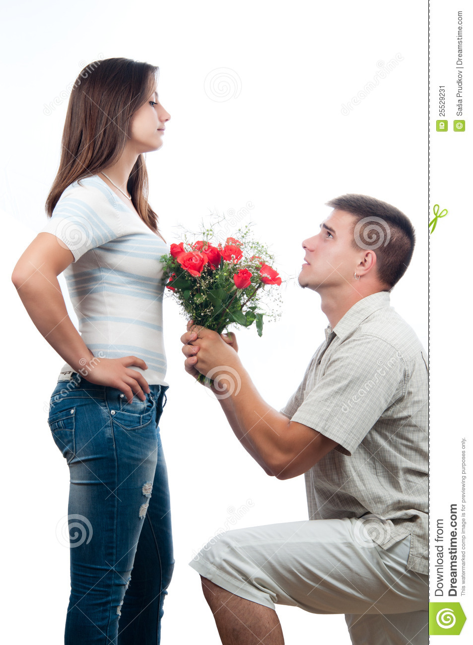 Handsome young men pleading for forgiveness and offering bouquet of ...