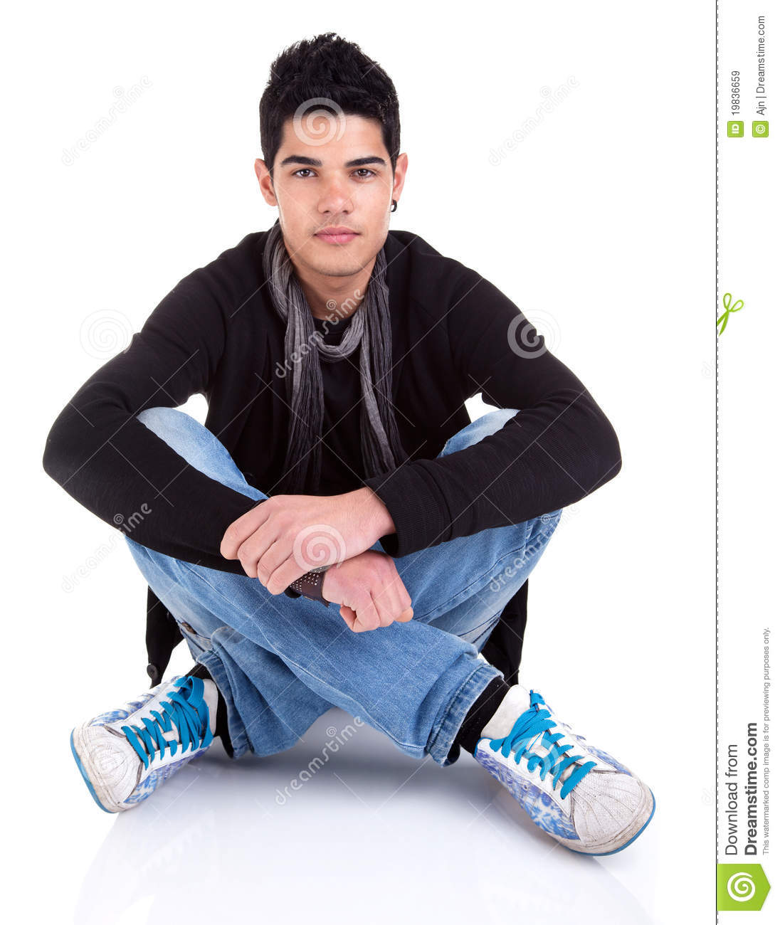 Handsome Young Man Sitting on the Floor