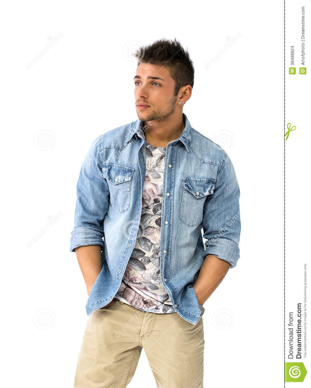 Handsome Young Man Standing With Open Denim Shirt Stock Photo