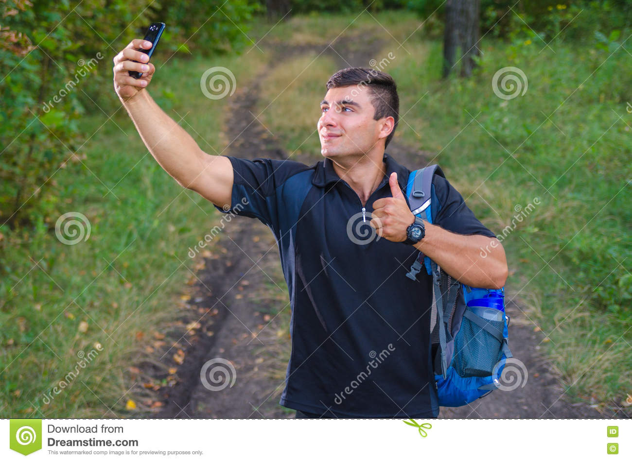 Handsome Young Man Taking A Selfie With A Phone, Smiling