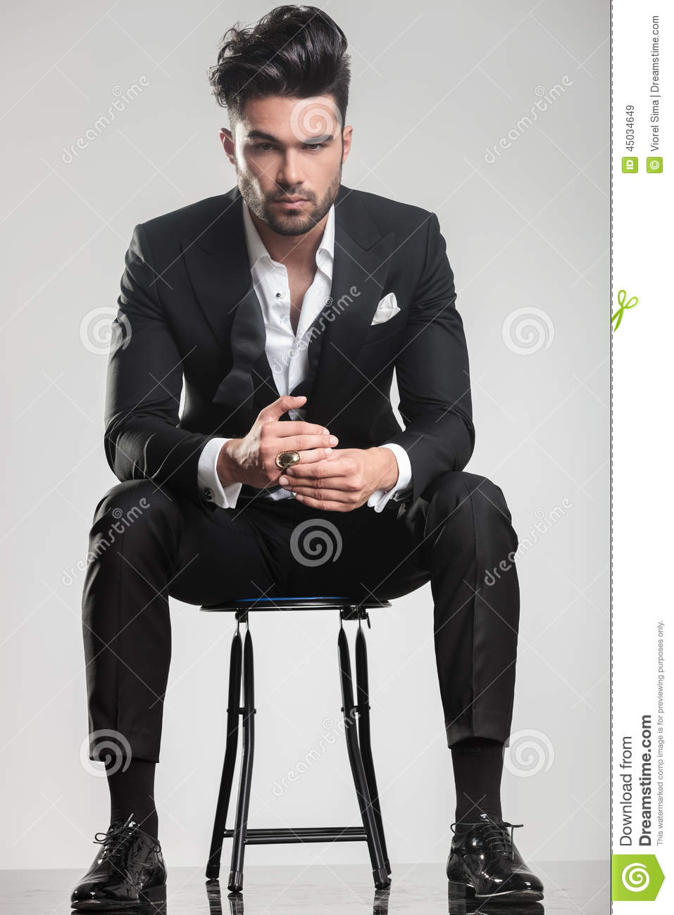Handsome Young Man In Tuxedo Sitting On A Stool Stock ...