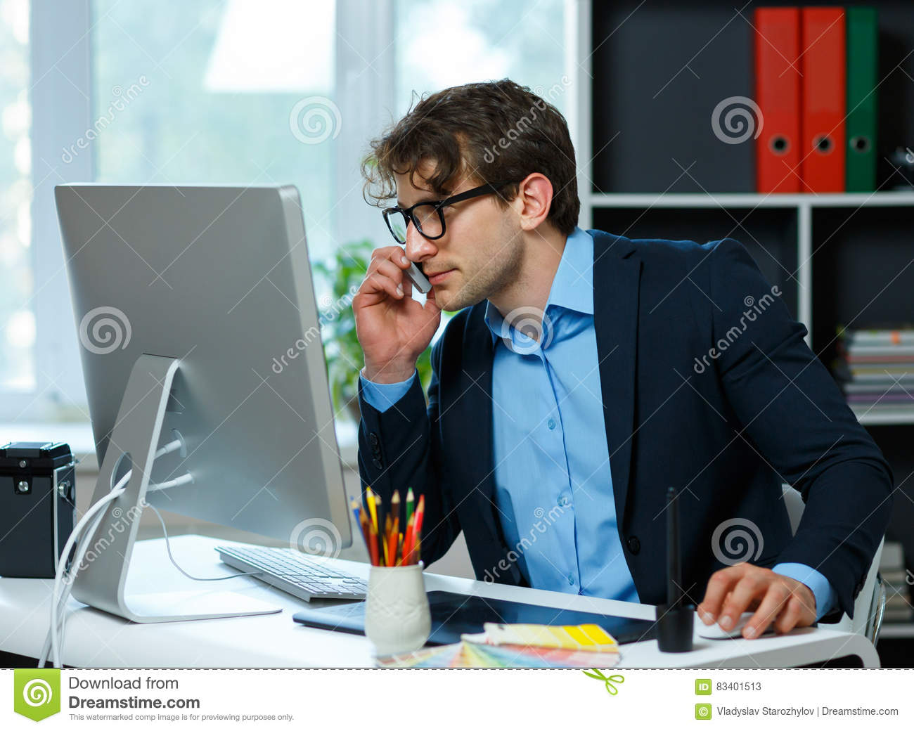 Handsome young man working from home office