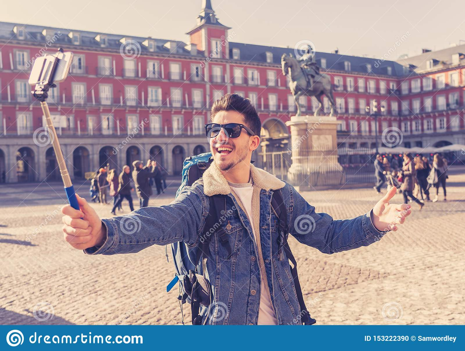 Handsome young student tourist man happy and excited taking a se
