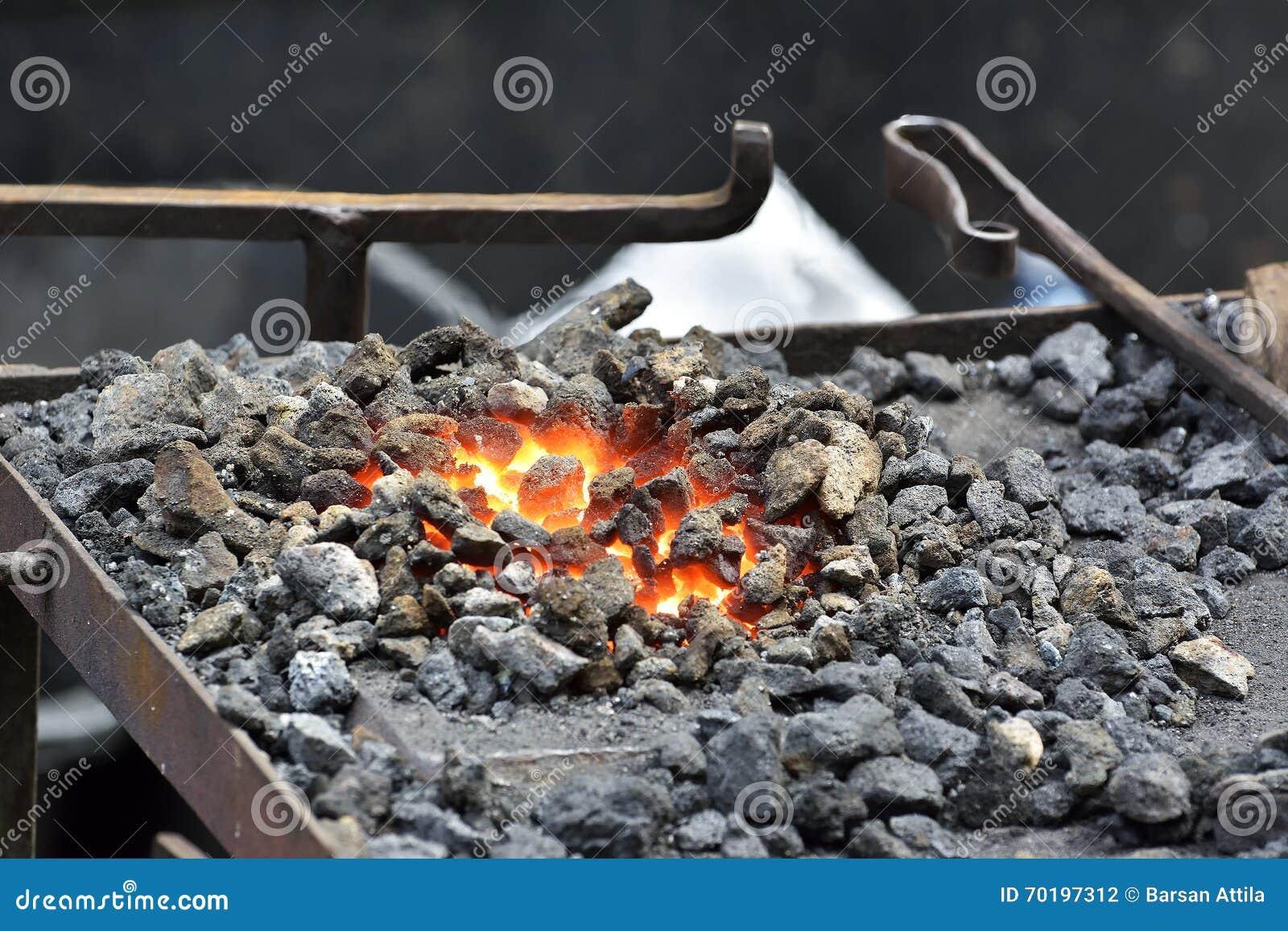 Handstäd med kol brand