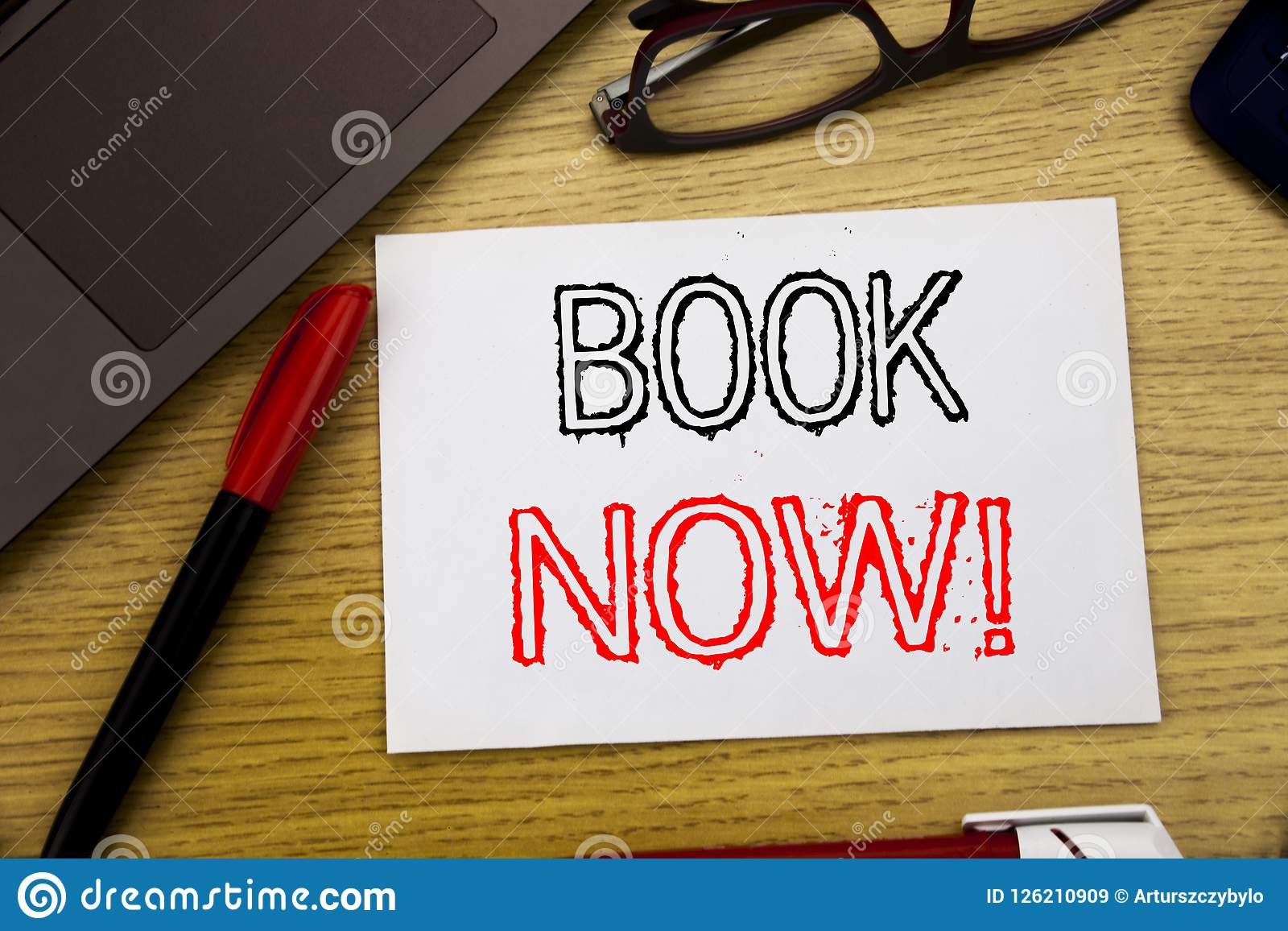 Handwriting Announcement text showing Book Now. Business concept for Reservation Booking written on paper, wooden background in of