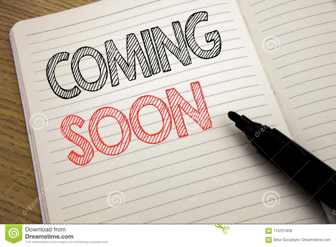 Handwriting Announcement text showing Coming Soon. Business concept for Under Construction written on notebook with copy space on