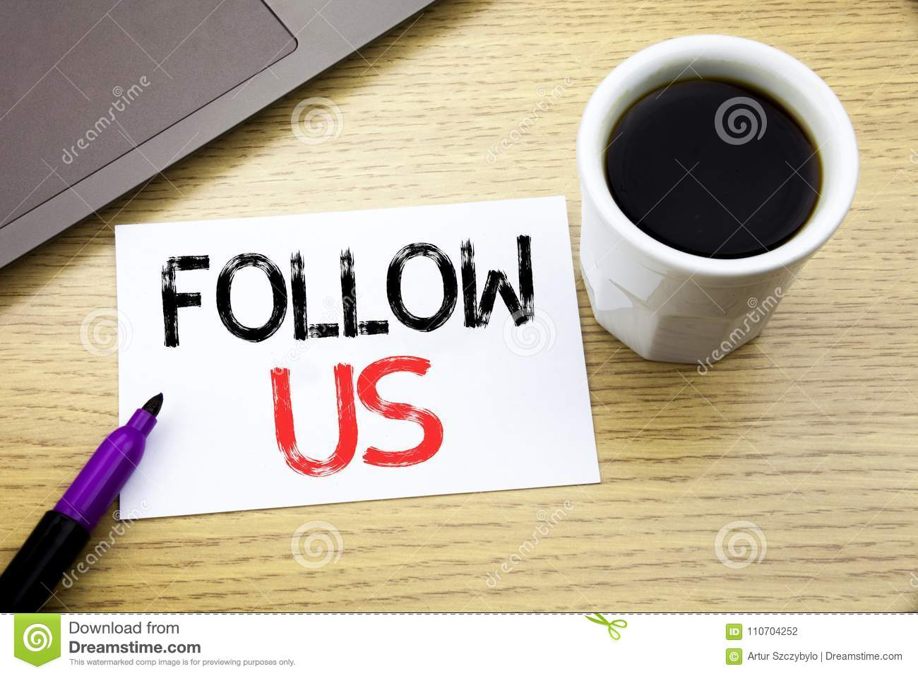 Handwriting Announcement text showing Follow Us. Business concept for Social Media Marketing written on notebook book on the woode