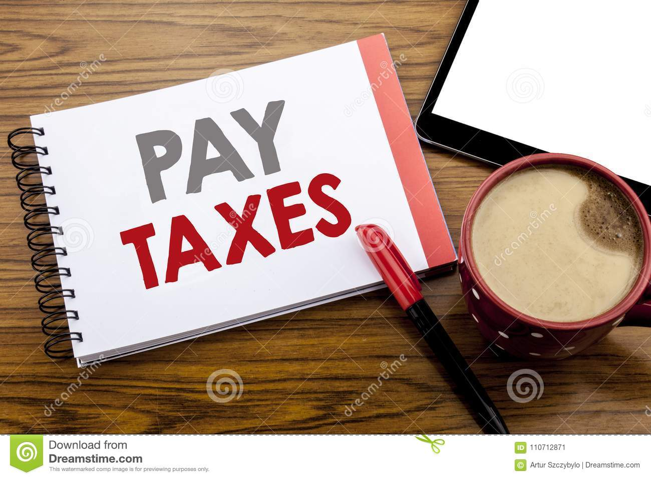 Handwriting Announcement text showing Pay Taxes. Business concept for Taxation Overtax Return Written on notepad note paper on woo