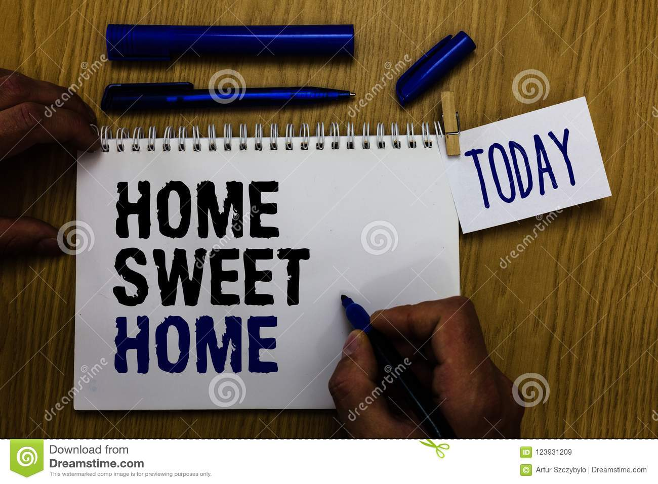 Handwriting text Home Sweet Home. Concept meaning In house finally Comfortable feeling Relaxed Family time Man holding marker note