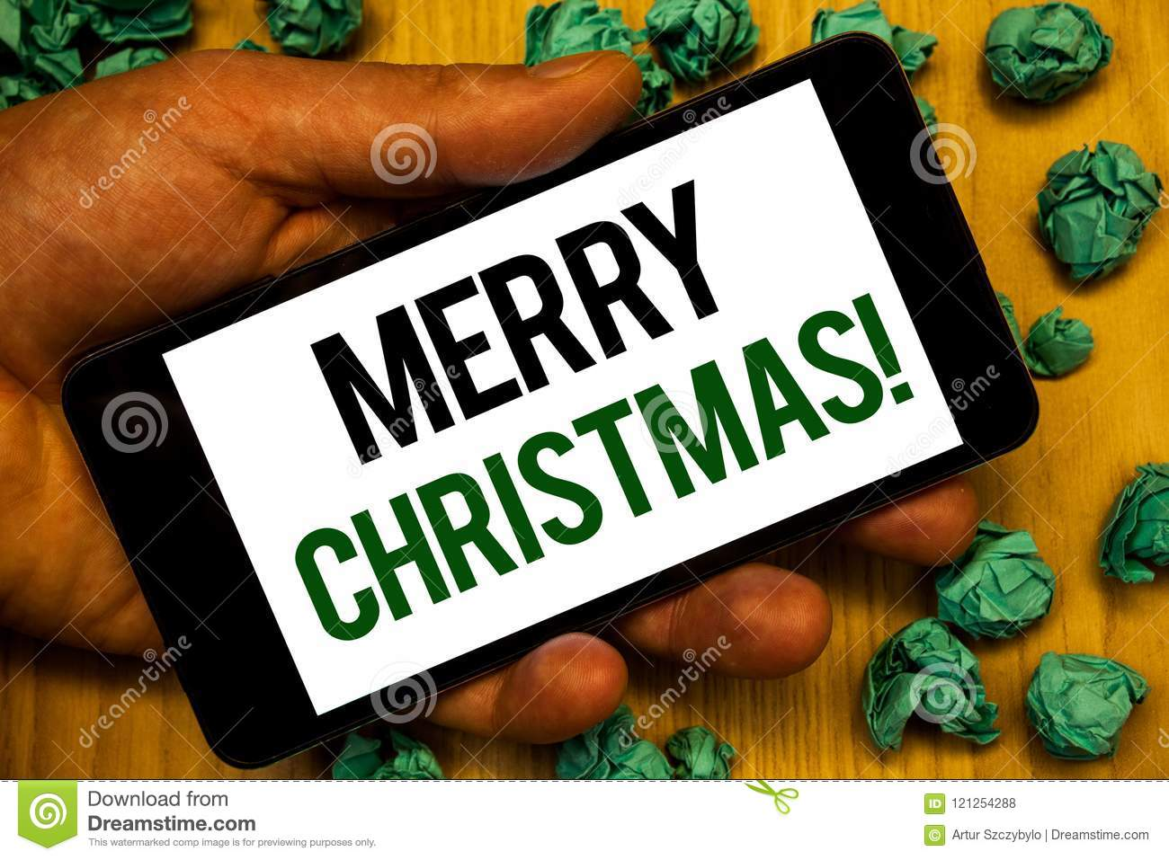 handwriting text merry christmas motivational call concept meaning holiday season celebration december hand holding phone - Merry Christmas Meaning