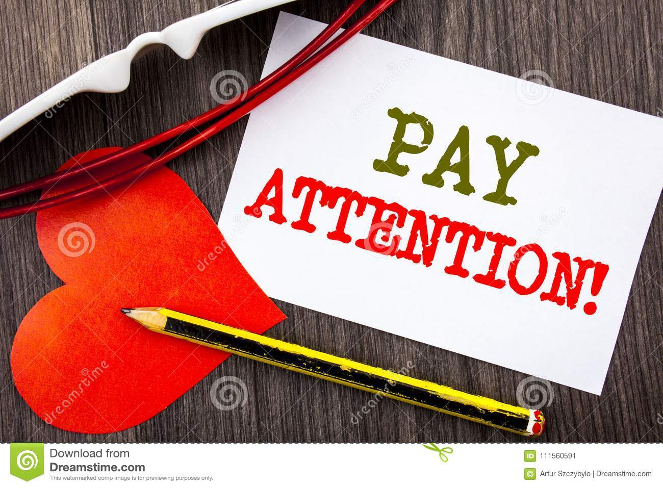 Handwriting text showing Pay Attention. Business concept for Be Careful Beware Mindful Alarm written on Sticky note paper with pen