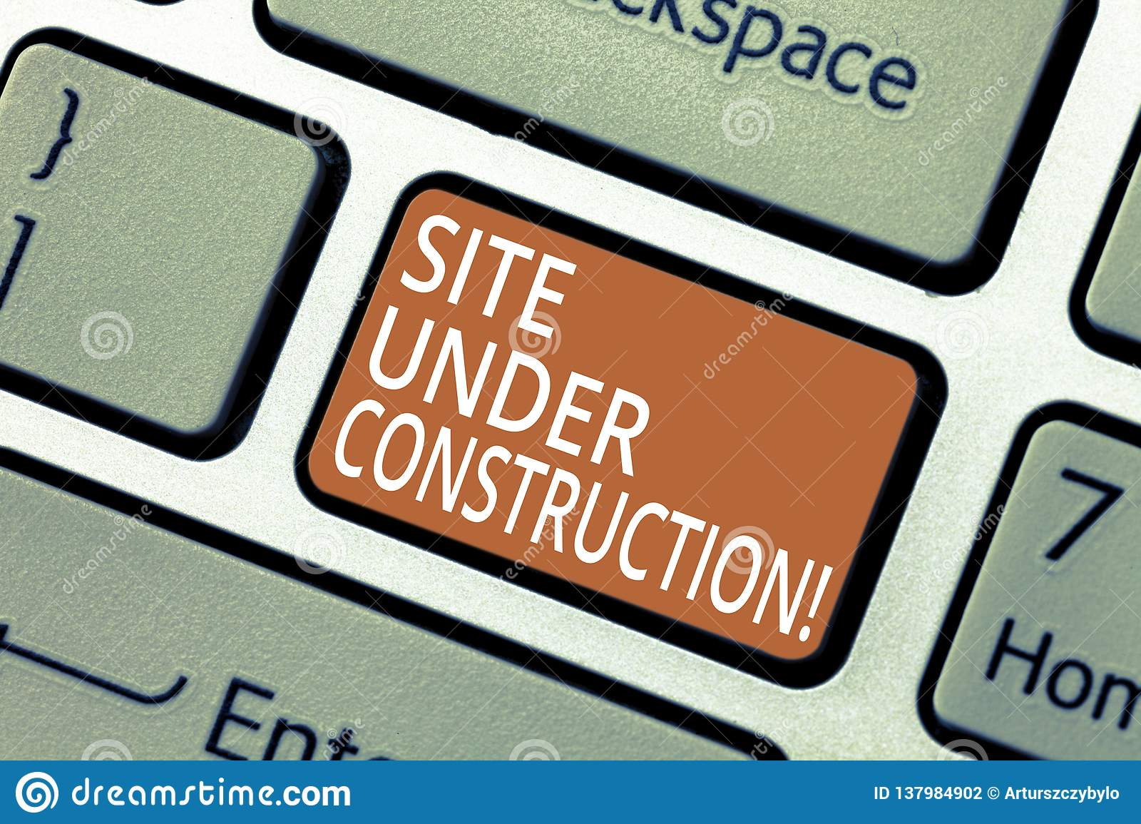 Handwriting text Site Under Construction. Concept meaning Implies something is being built for the first time Keyboard