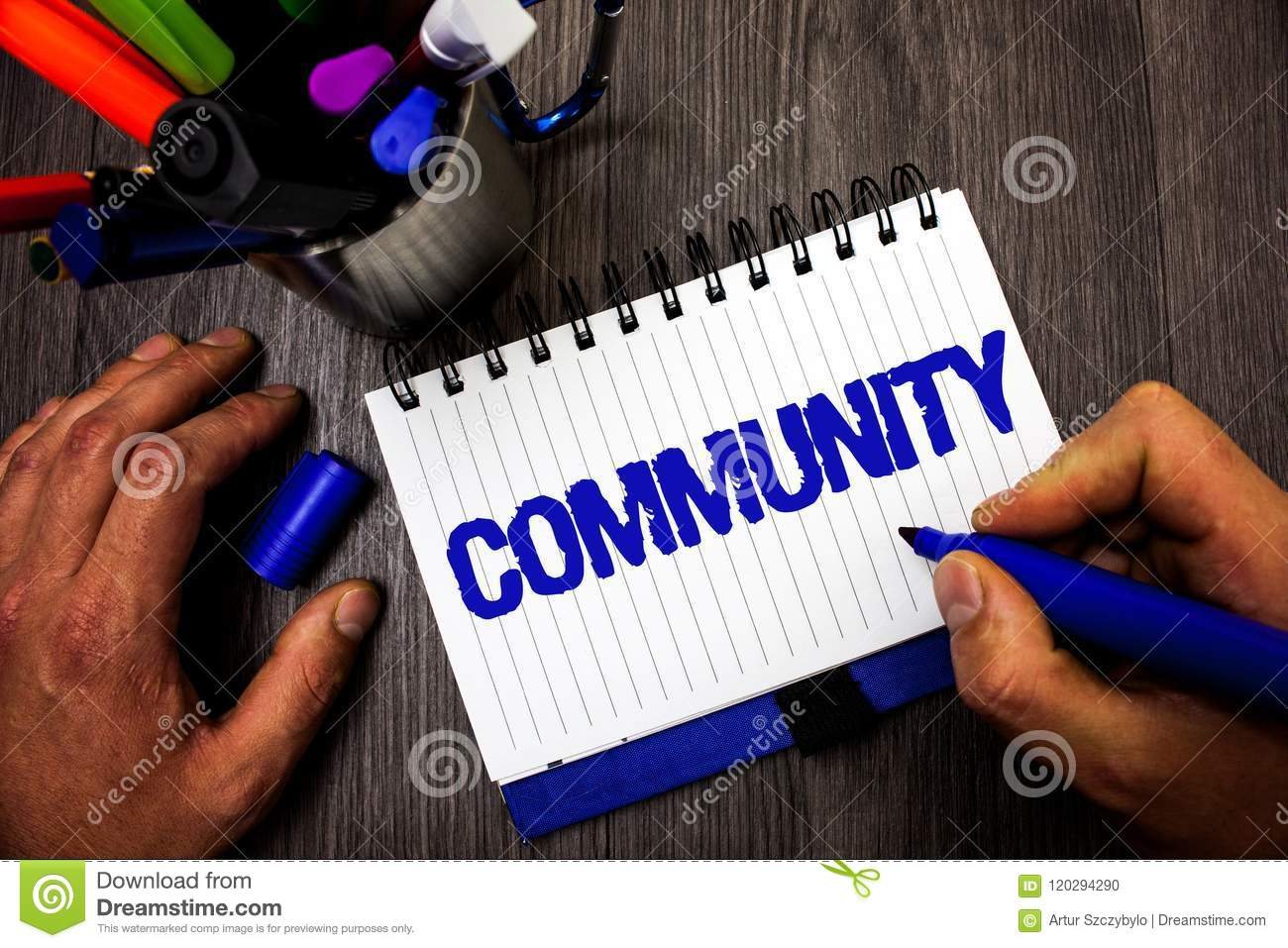 Handwriting text writing Community. Concept meaning Neighborhood Association State Affiliation Alliance Unity Group Man hold holdi