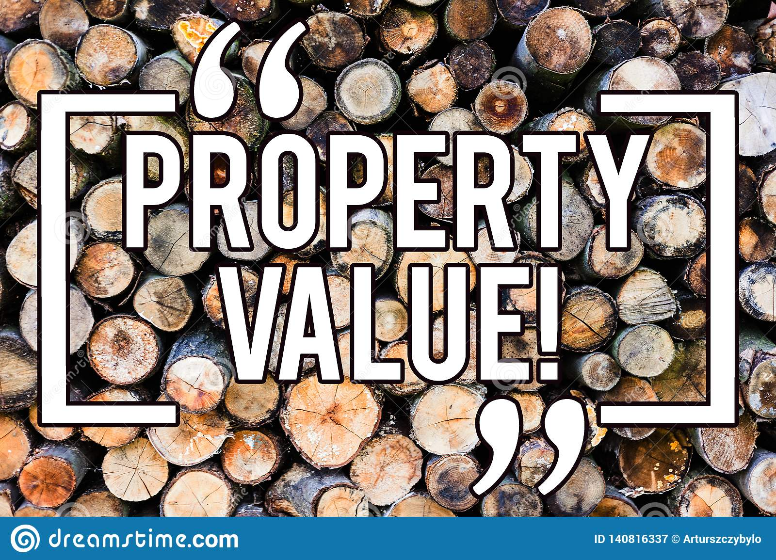 Handwriting text writing Property Value. Concept meaning Estimate of Worth Real Estate Residential Valuation Wooden background