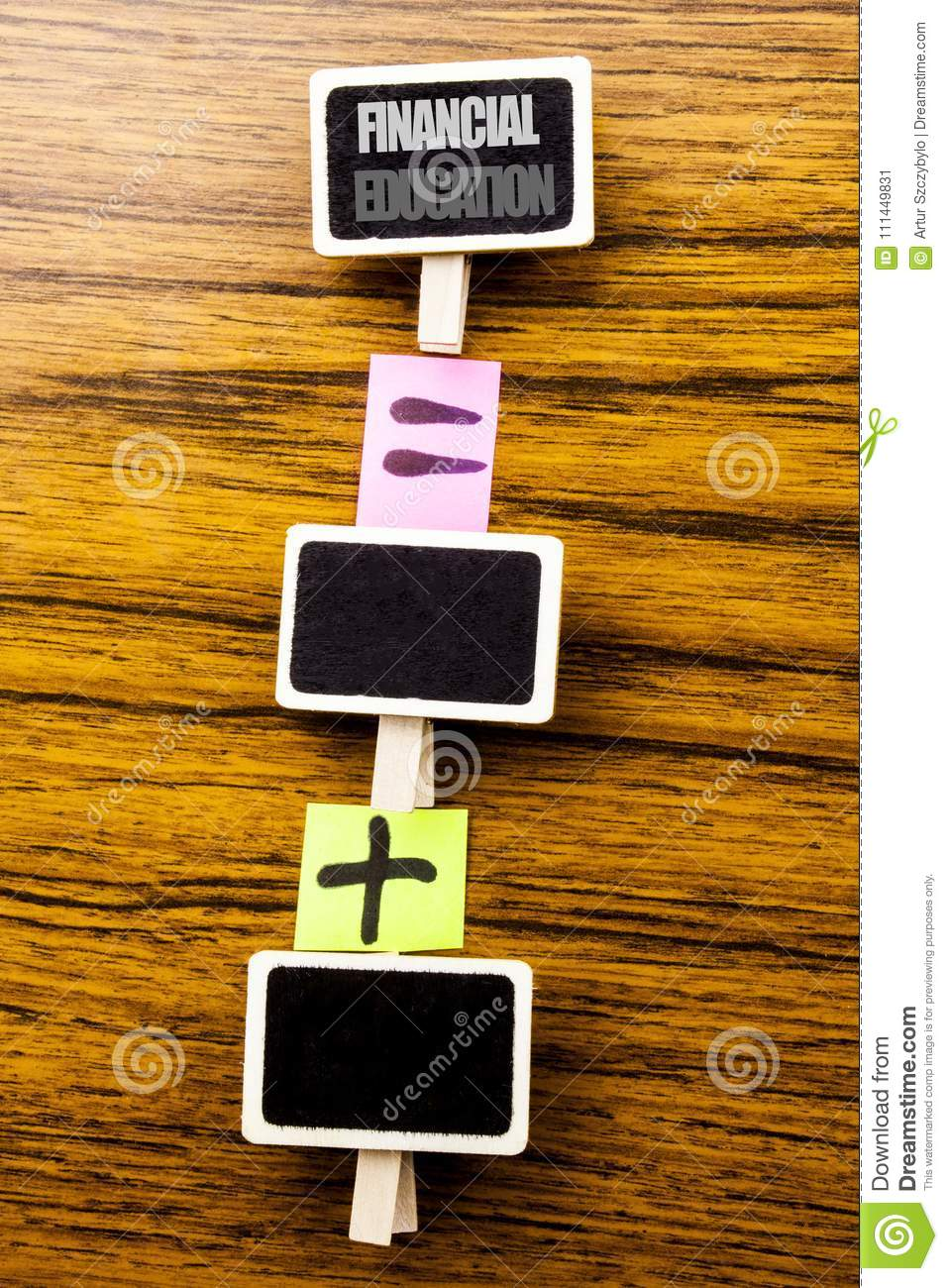 Handwritten text showing Financial Education. Business concept for Finance Knowledge Written on clips, wooden background for equat