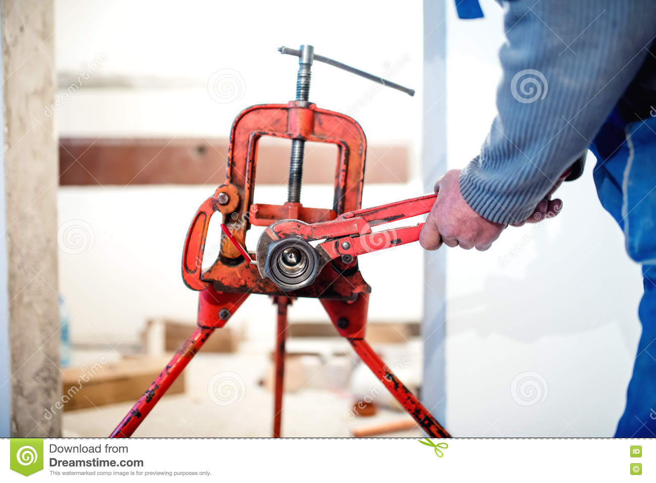 Handyman Plumber Adjusting Pipes With Wrench At Construction Site ...