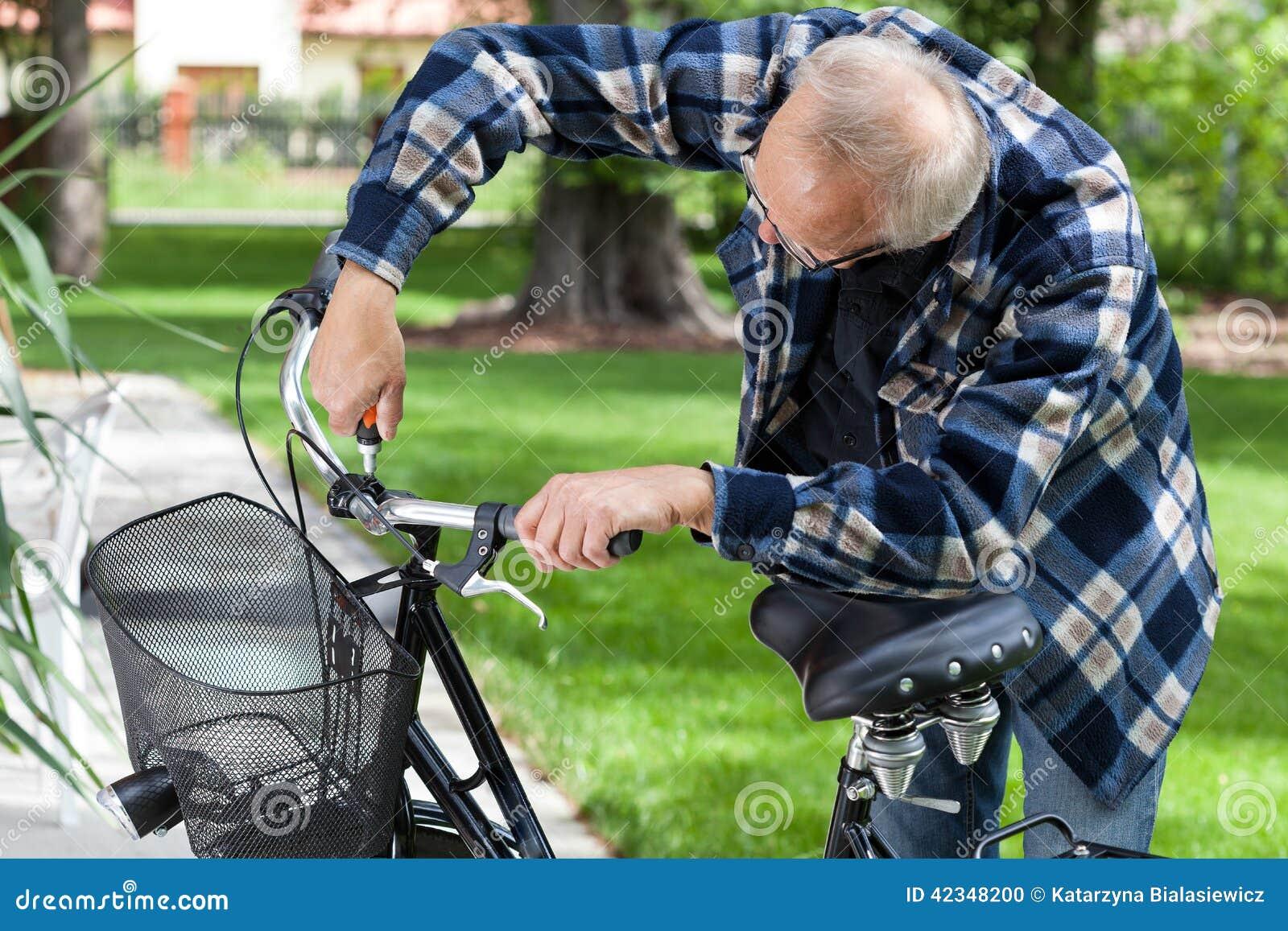 Handyman repairing bicycle handlebar