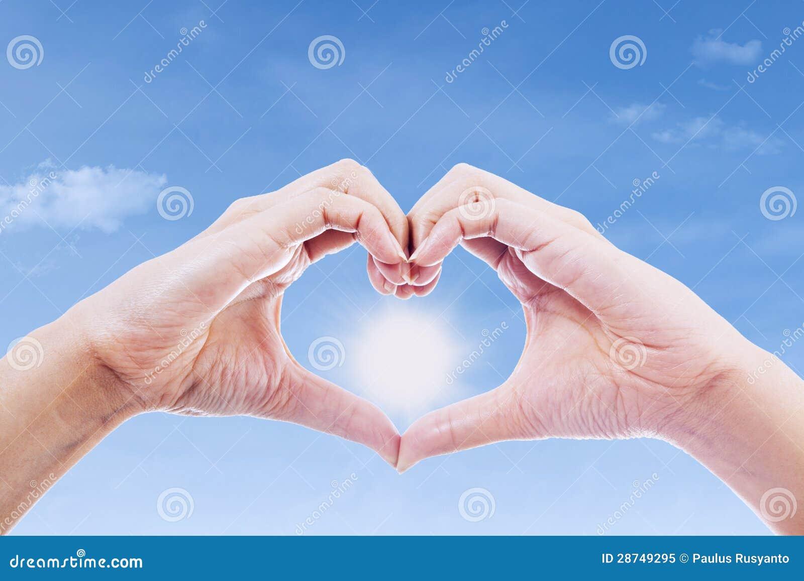Handzeichen Der Liebe Und Der Sonne Stockbild - Bild von