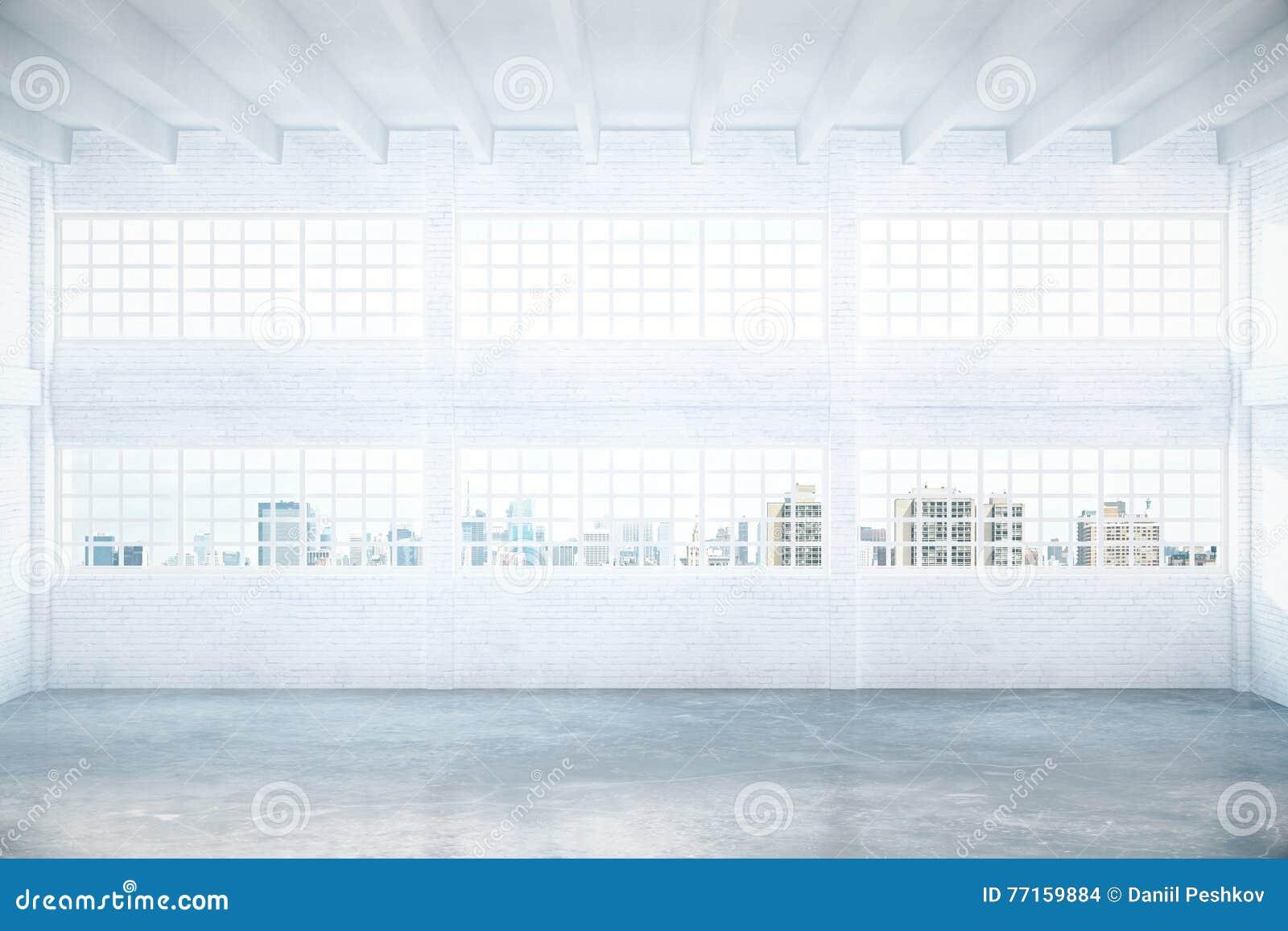 Hangar vide avec la vue de ville