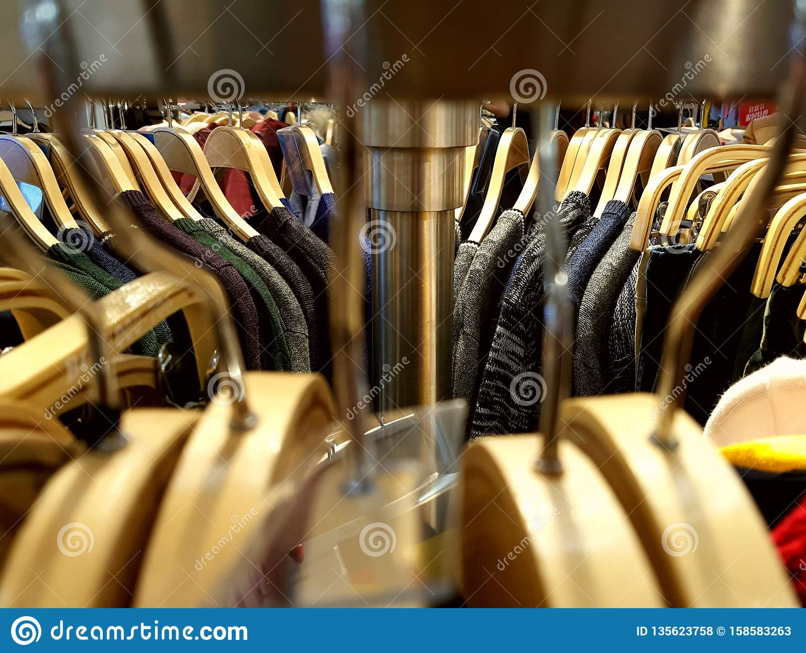 Exhibition Stand Clothes : Clothes hangers arranged on the exhibition stand stock photo image