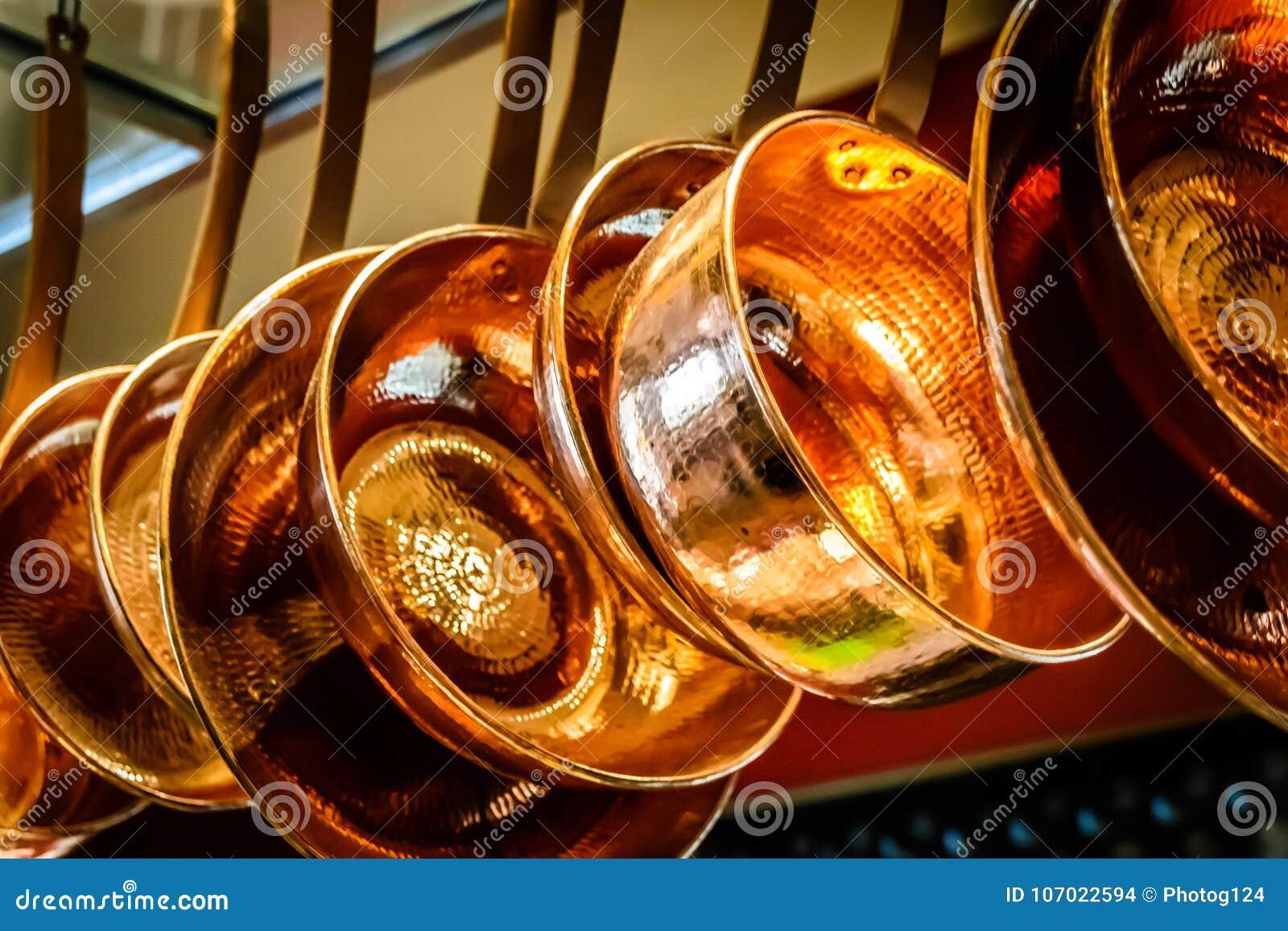 Hanging copper pots pans saucepans Hanging Copper