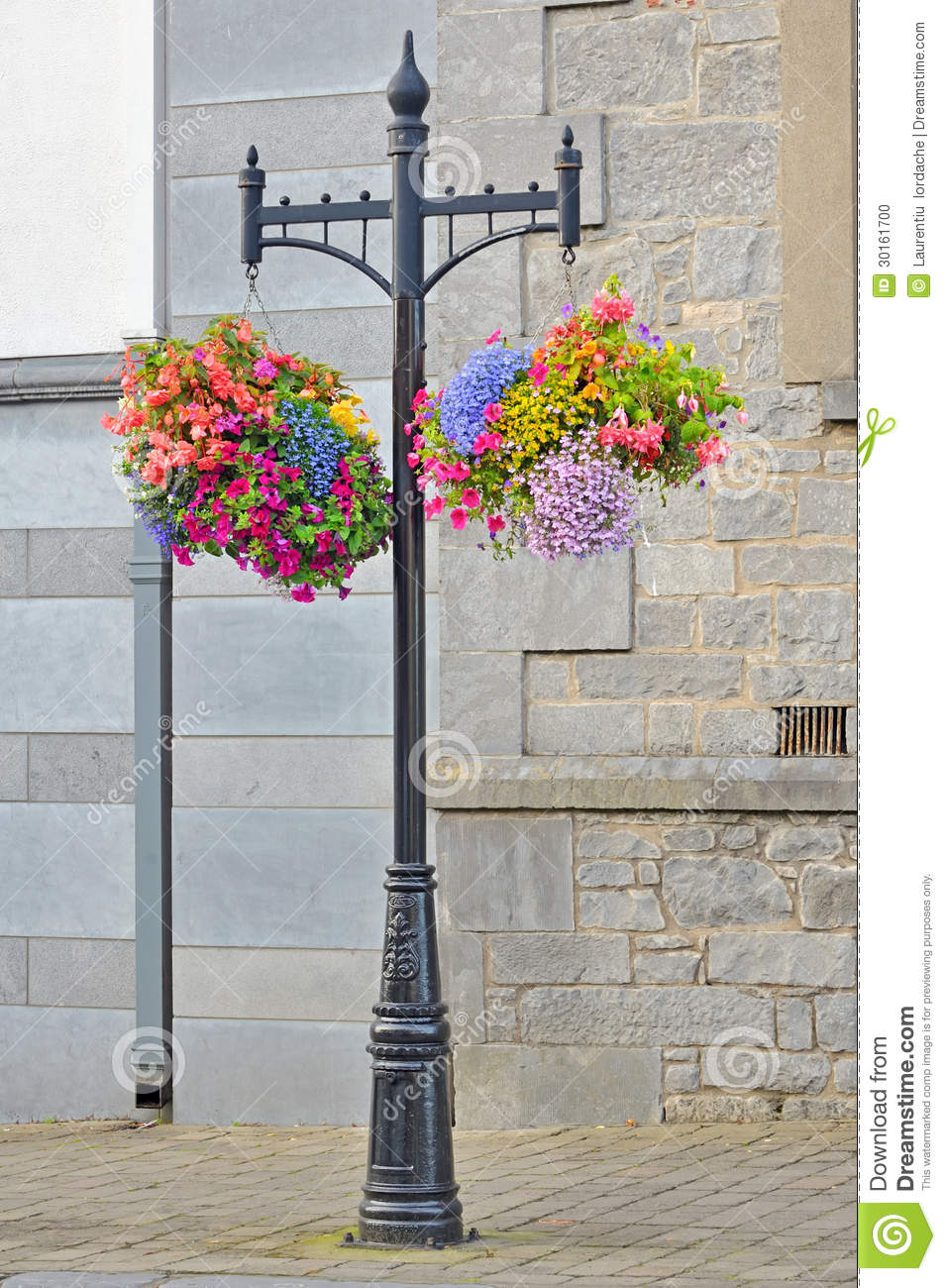 Decorative Lamp Post With Flower Basket Hanging From It