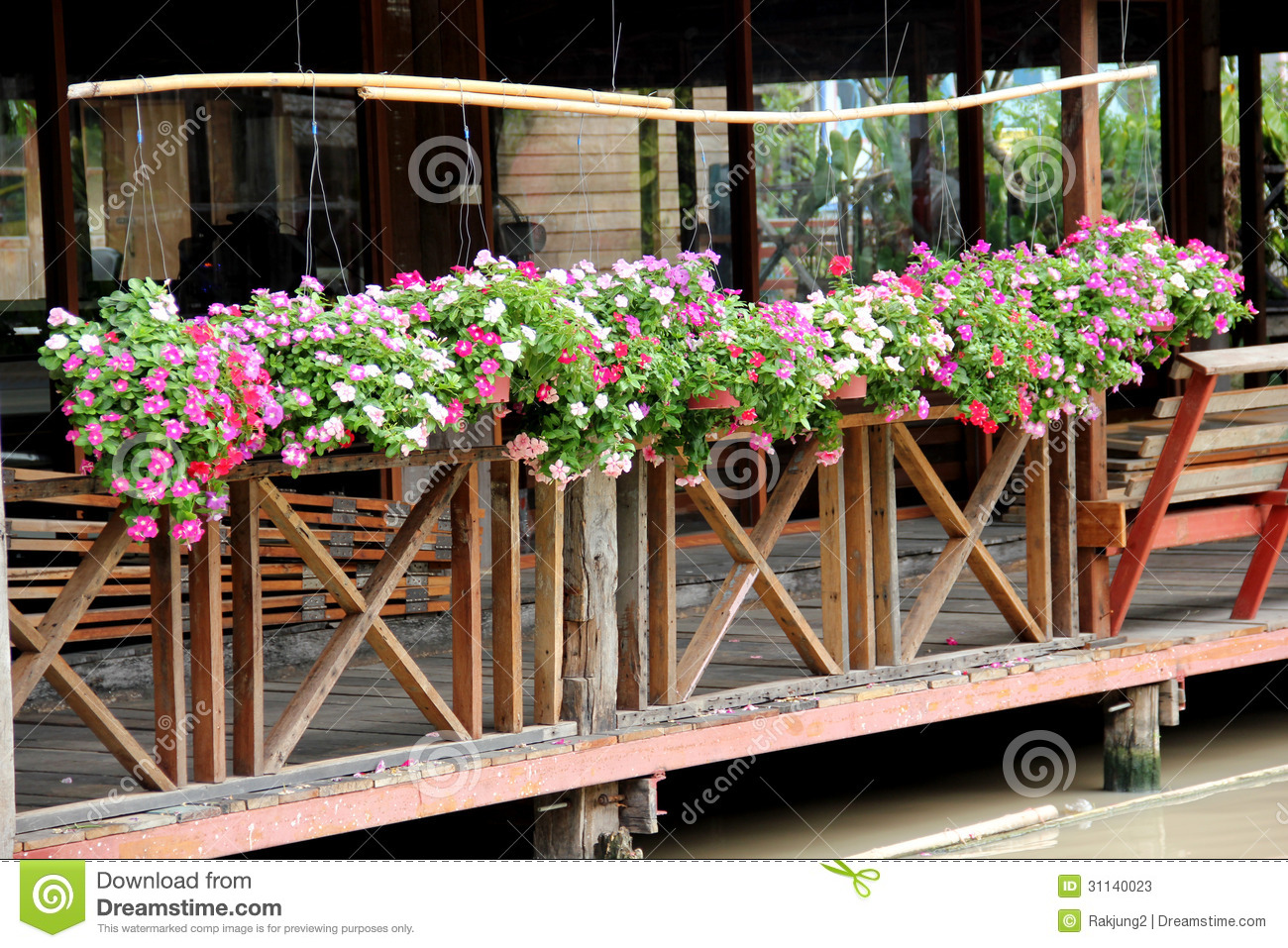 Hanging flower pots stock photos image 31140023 - Flower pots to hang on fence ...