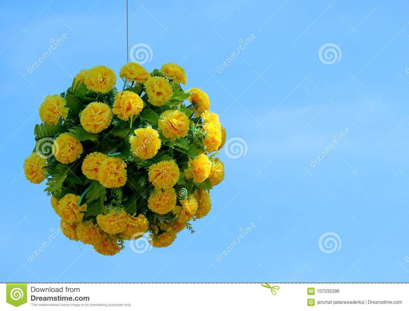 A Hanging Full Bloom Of Yellow Flower Bouquet In Sphere Shape With