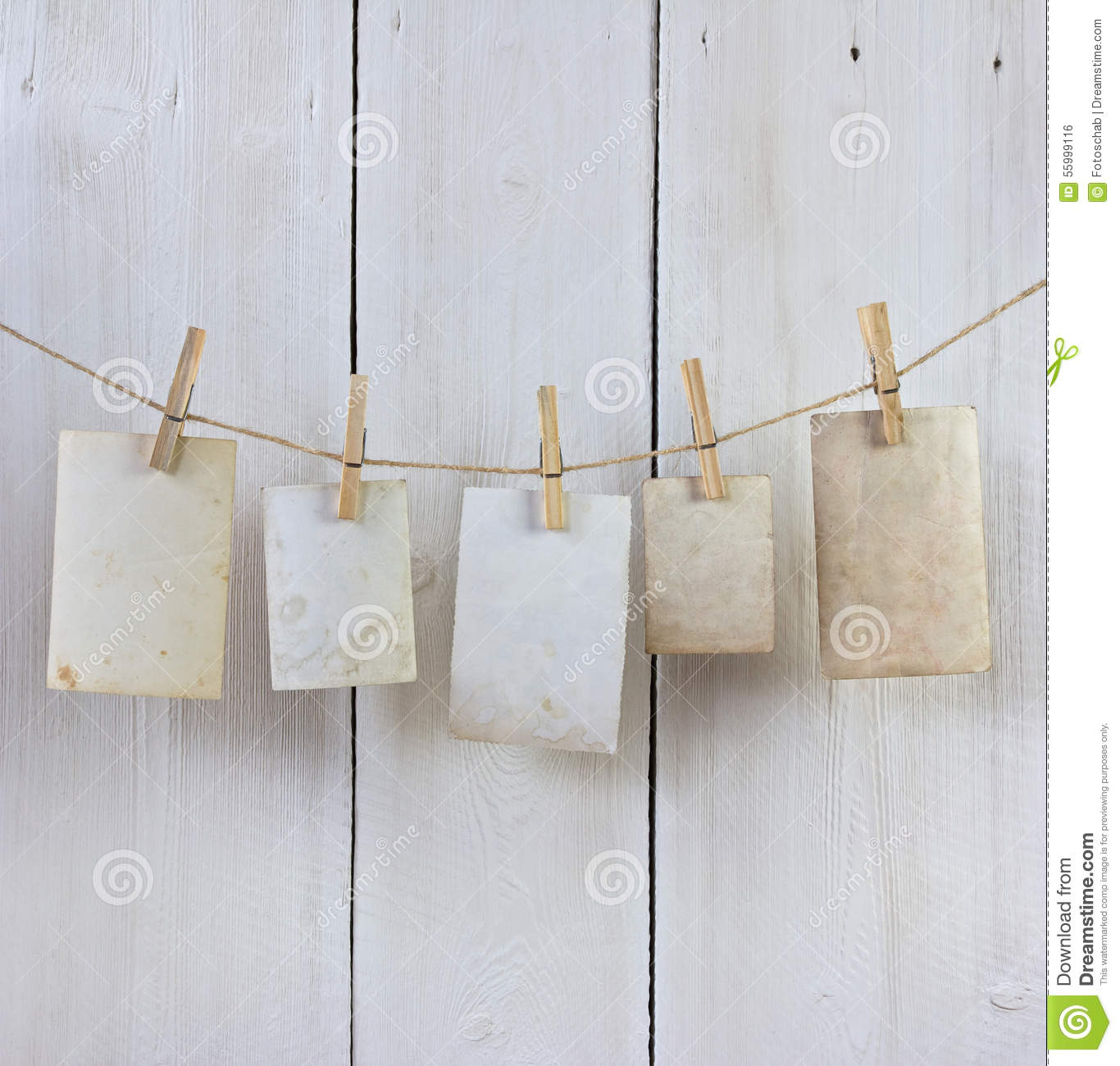 Hanging photos stock photo image 55999116 for Clothespin photo hanger