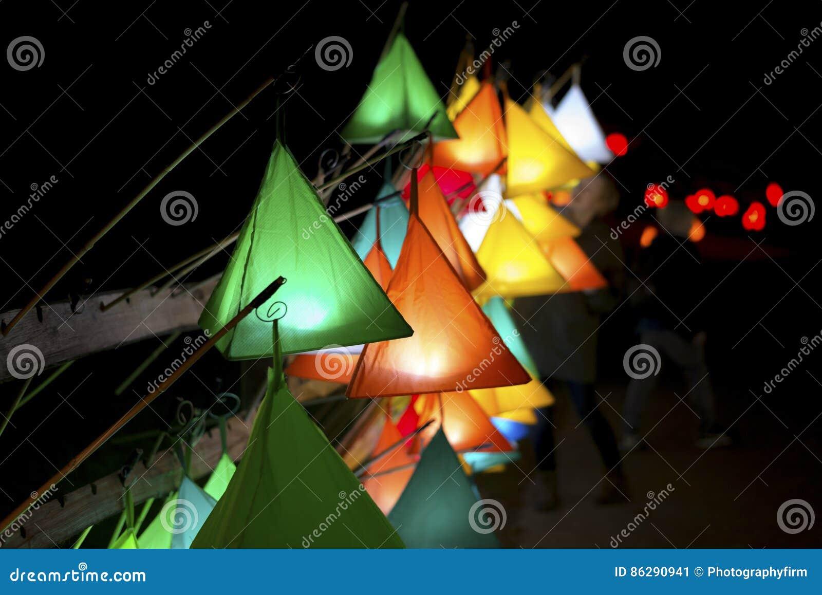 Hanging Pyramid-Shaped Glowing Lanterns