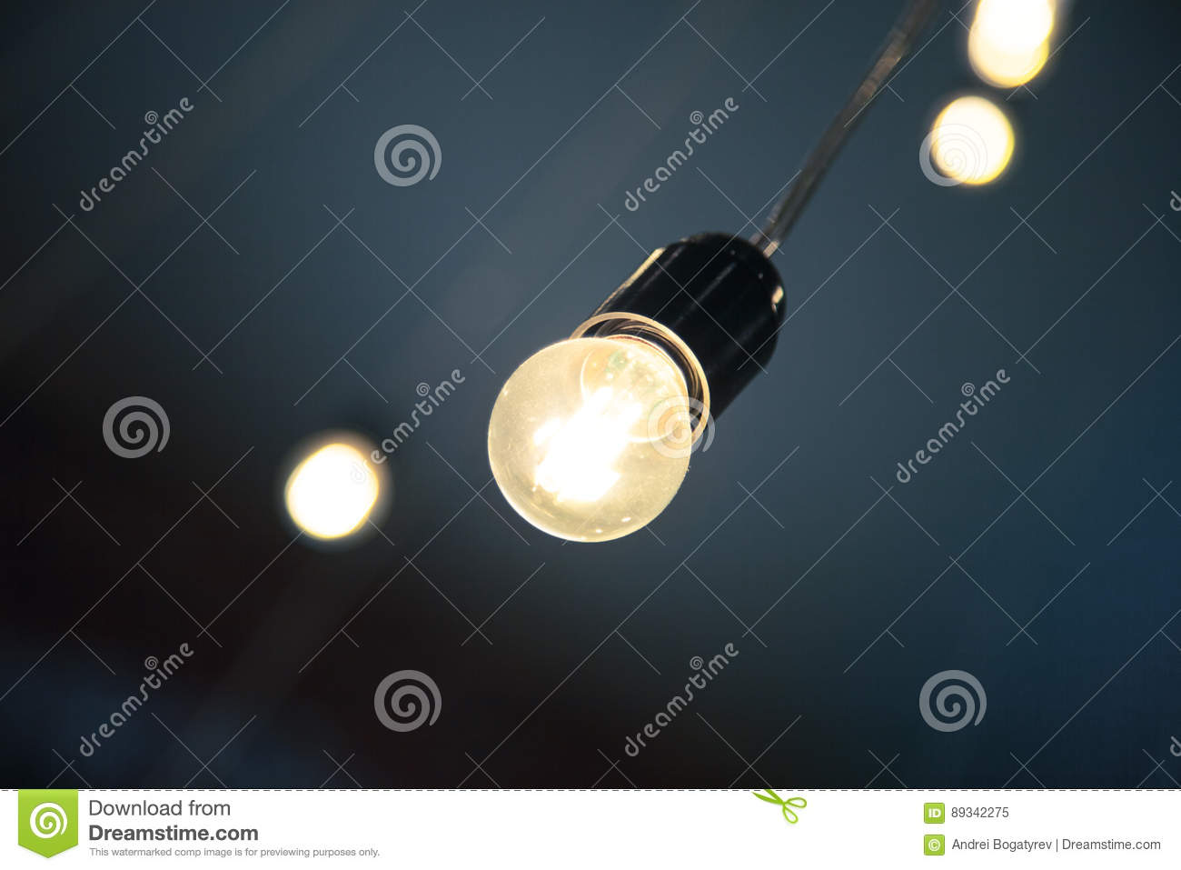 Hanging Retro Light Bulb In The Cafe Or Coffee Shop Interior Design