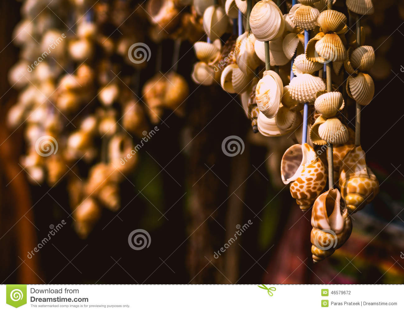 Hanging Shells In A Shop Beside A Beach