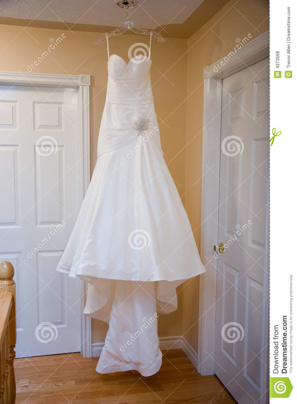 Hanging Wedding Dress stock photo. Image of doors, elegant - 4973568