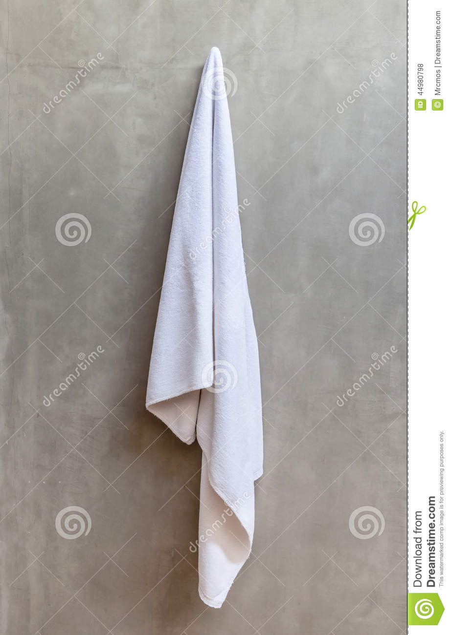 Hanging White Towel Draped On Exposed Concrete Wall In The Bathr Stock ...